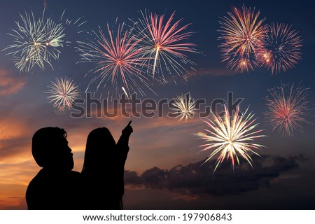 Happy father and daughter looks fireworks