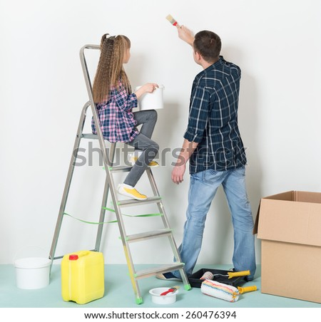 Happy father and daughter makes repairs at home. - stock photo