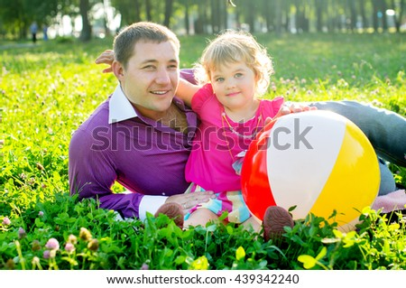 Happy father and daughter playing on nature - stock photo