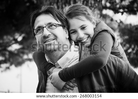 Happy father and daughter smiling - stock photo