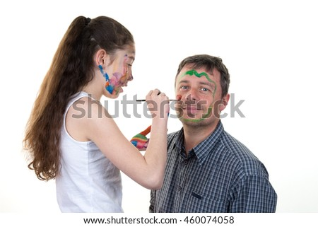 Happy father and daughter with paint on faces