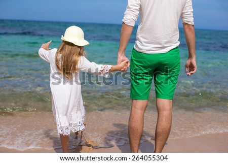 Happy father and his adorable daughter at white sandy beach - stock photo