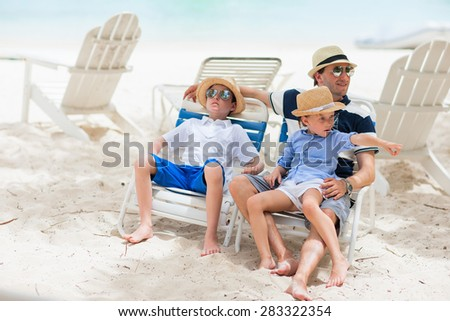 Happy father and his adorable kids enjoying summer vacation - stock photo