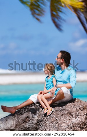 Happy father and his adorable little daughter enjoying tropical beach - stock photo