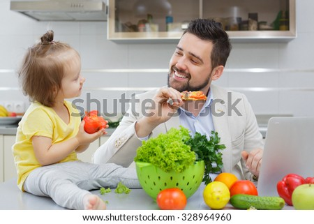 happy father and his child have fun during lunch - stock photo