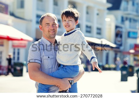 Happy father and his cute little son outdoors during his summer vacation - stock photo