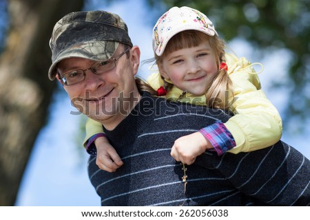 Happy father and his daughter in summer park - stock photo