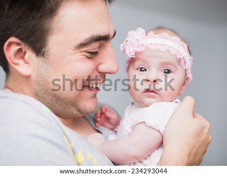 Happy father and his Newborn Baby. - stock photo