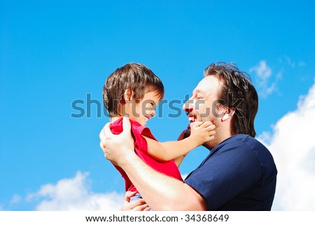 Happy father and his son outdoor - stock photo