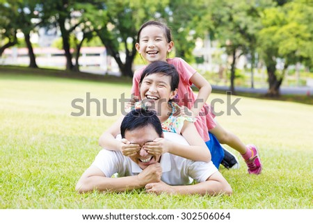 happy father and little girl lying on the grass - stock photo