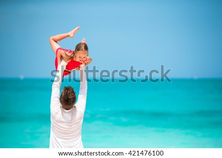 Happy father and little girl on tropical beach  - stock photo