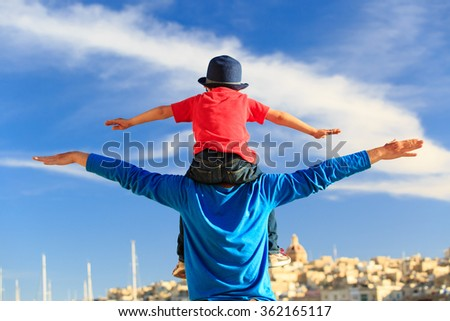 happy father and little son play on sky