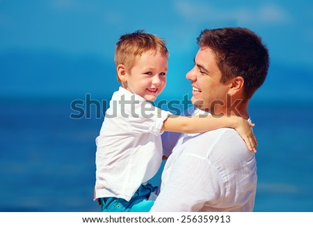 happy father and son embracing, family relationship