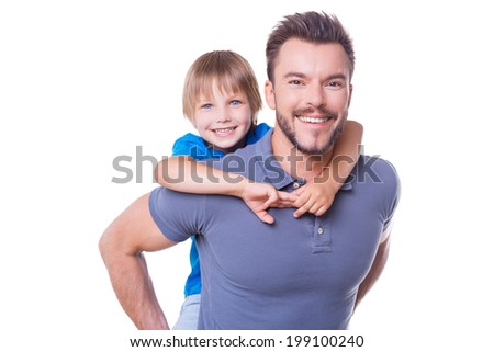 Happy father and son. Happy father carrying his son on back and smiling while both standing isolated on white - stock photo