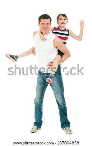 Happy father and son having fun riding on the back isolated on white - stock photo