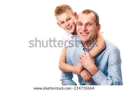 happy father and son in blue and white shirt on a white background. Son hugging father
