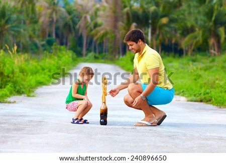 happy father and son making chemical experiment, funny education - stock photo