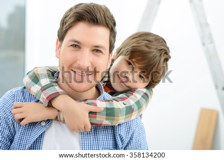 Happy father and son making renovation  - stock photo