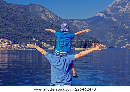 happy father and son on sea vacation - stock photo