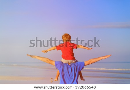 happy father and son playing on sky - stock photo