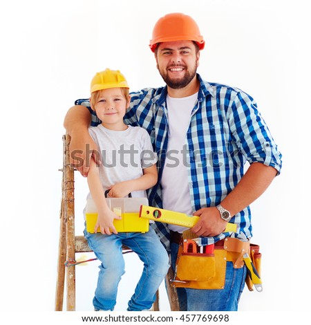 happy father and son ready to repair a house - stock photo