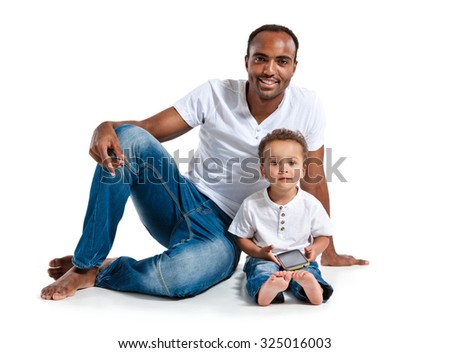 Happy father and son using smart phone. Learning and early education concept / photos of Hispanic man and mixed race boy over white background