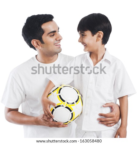 Happy father and son with soccer ball - stock photo