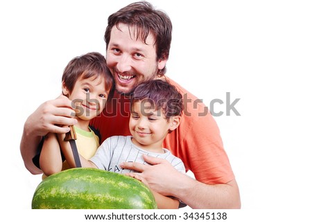 Happy father and two kids preparing watermelon - stock photo
