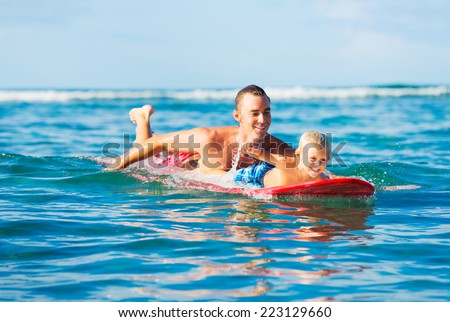 Happy Father and Young Son Going Surfing Together. Fatherhood Concept, Quality Time with Child. - stock photo