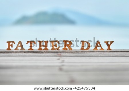 Happy father day concept, word of wooden father day on wood on sea view background idea