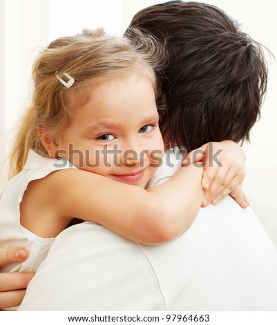Happy father embracing with daughter. Family at home