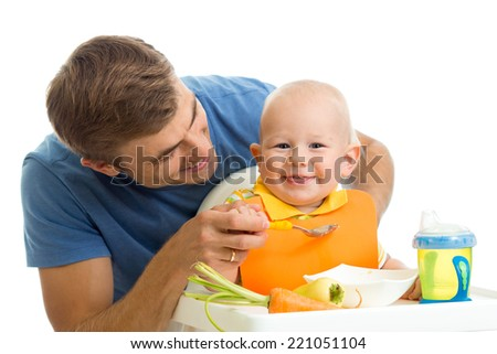 happy father feeding baby son