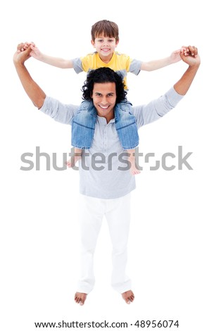 Happy father giving piggyback ride to his son isolated on a white background