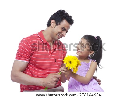 Happy father giving sunflowers to daughter over white background - stock photo