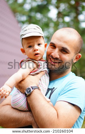 Happy father holding his son - stock photo
