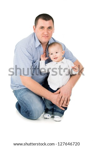 happy father hugs little son isolated on white background