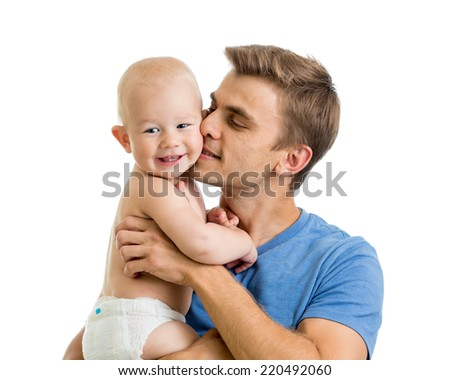 happy father kissing baby boy isolated on white - stock photo