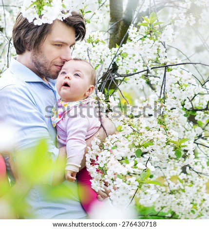 Happy father kissing his baby - stock photo
