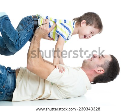 happy father playing with son kid lying on floor - stock photo