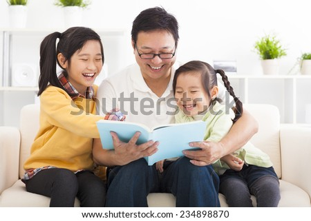 happy father read the book to children - stock photo