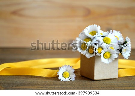 Happy Father's Day card: Daisy flowers arranged in gift box - stock photo
