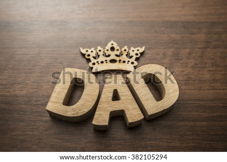 Happy Father's Day - Wood letters- wooden crown above dad word - stock photo