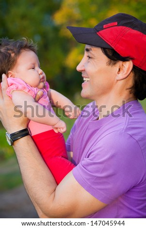 happy father with baby outdoors - stock photo