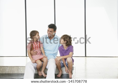 Happy father with children spending time together at home - stock photo