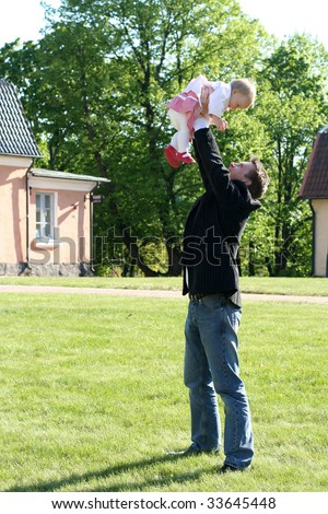 Happy father with daughter - stock photo