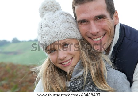 Happy father with daughter in fall season