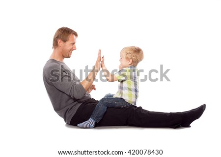 Happy father with his baby son play together - stock photo