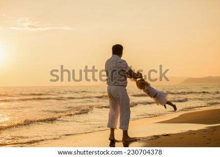 Happy father with his little child by the seaside at sunset, summer time. Fatherhood concepts, Italy, Forte dei Marmi - stock photo