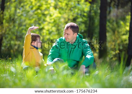 Happy father with his little son outdoors - stock photo