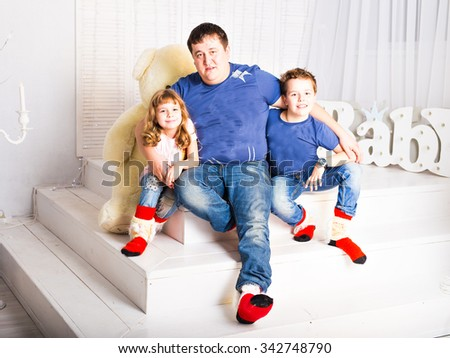 happy  father with his son and daughter - stock photo